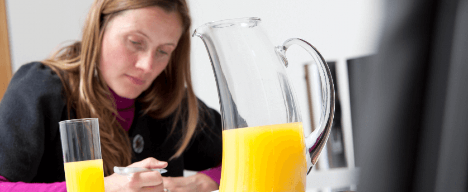 Conference with Orange Juice in Bravura Jug and Glass